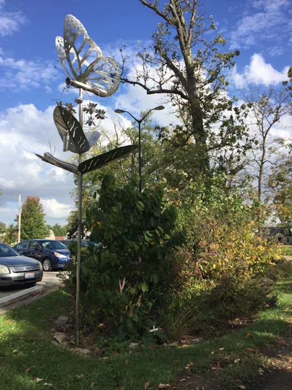 rain gardens and butterfly sculpture in westgate park.