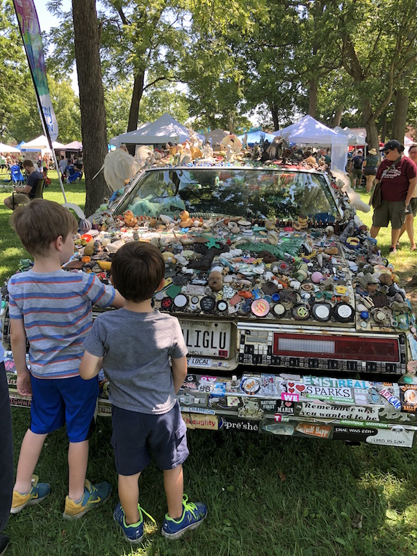 boys looking at the art cars at the Summer Jam West Festival in Westgate Park.