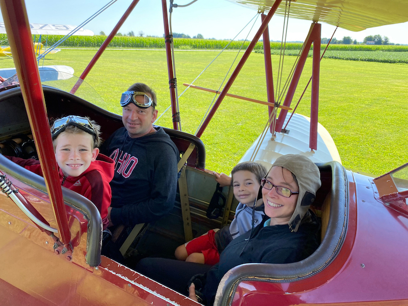 Family inside a bi-plane in Greene County, Ohio.