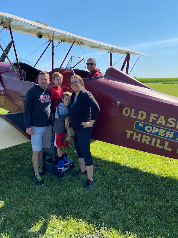 Family and pilot taking a bi-plane ride in Greene County, Ohio.