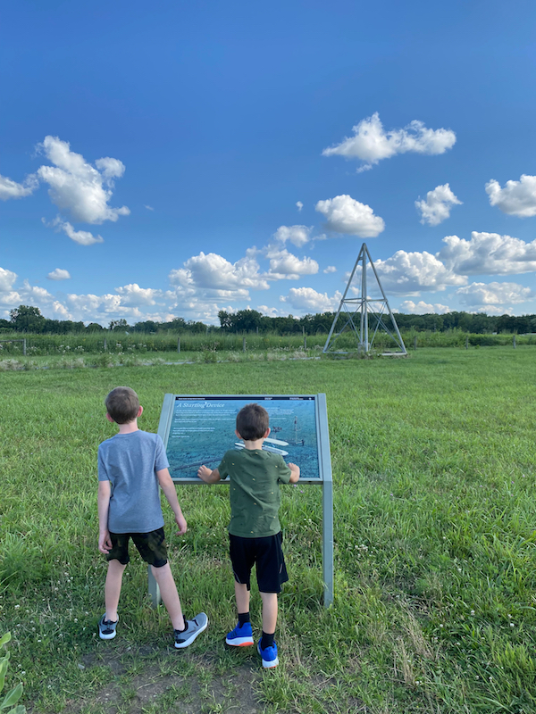 Two boys reading the informational sign at Huffman Prairie Flying Field in Greene County, Ohio.