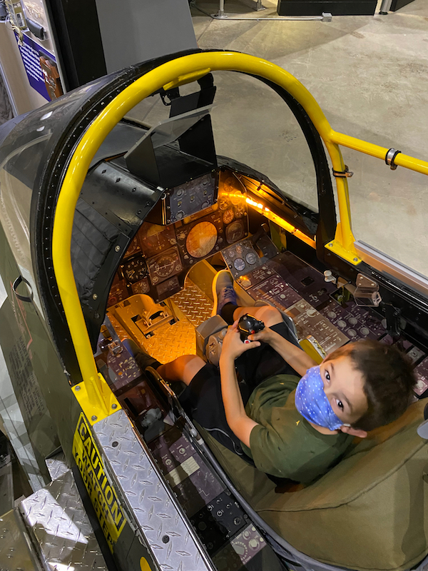 Boy inside a cockpit at the National Museum of the U.S. Air Force.